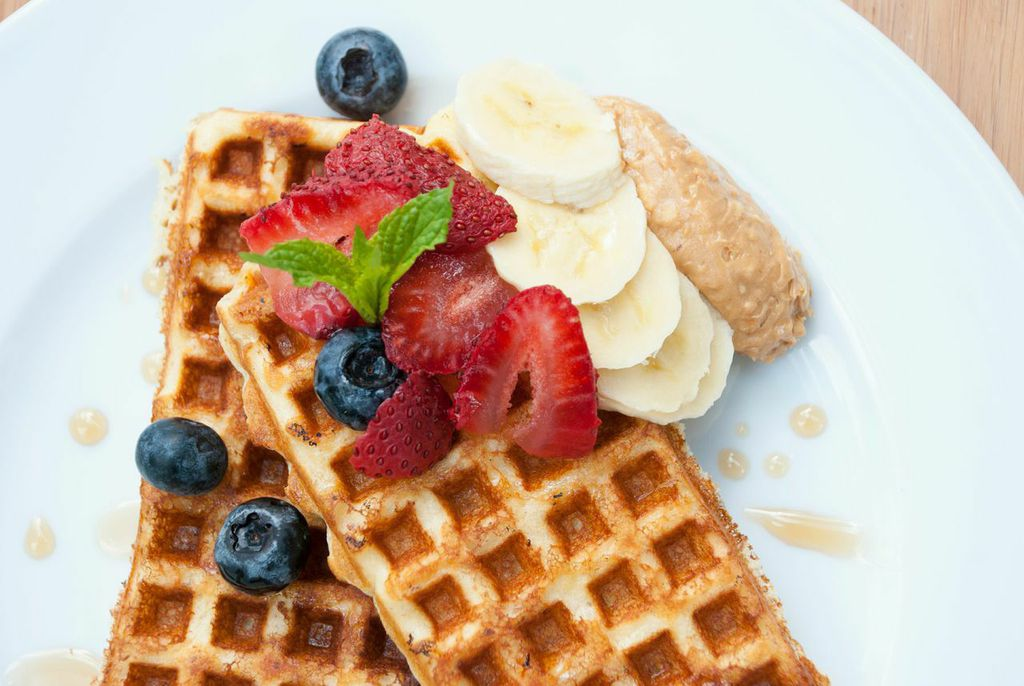 Oat flour waffle with berries and almond butter